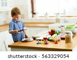 cute child learning to become a ... | Shutterstock . vector #563329054