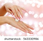 woman hands with a cream on an... | Shutterstock . vector #563330986