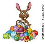 easter bunny on an egg hunt... | Shutterstock .eps vector #563335840