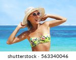 happy woman on the beach | Shutterstock . vector #563340046