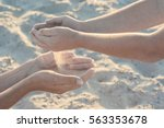 mother and child play with sand.... | Shutterstock . vector #563353678
