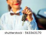 young woman standing near a... | Shutterstock . vector #563363170