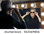 American Man With Glasses...