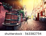 narrow cobblestone street in... | Shutterstock . vector #563382754