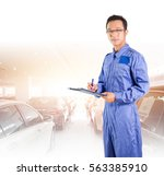 asian mechanic man in coverall... | Shutterstock . vector #563385910