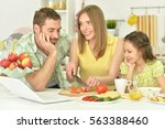 family together on the kitchen | Shutterstock . vector #563388460
