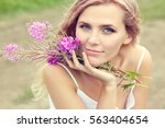 outdoor portrait of a beautiful ... | Shutterstock . vector #563404654