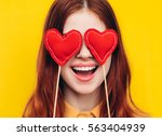 young woman with hearts  eyes...   Shutterstock . vector #563404939