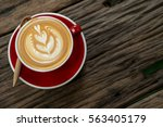 red cup of cappuccino with... | Shutterstock . vector #563405179