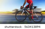 man on a bicycle on a road with ... | Shutterstock . vector #563413894