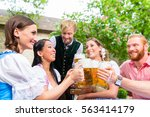 ive friends in bavarian clothes ... | Shutterstock . vector #563414179