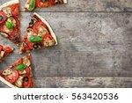 vegetarian pizza slice with... | Shutterstock . vector #563420536