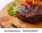 steak on cutting board on... | Shutterstock . vector #563422834