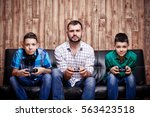 father and son playing in the... | Shutterstock . vector #563423518