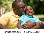 african american father and his ... | Shutterstock . vector #563423680