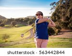 mature woman playing golf....   Shutterstock . vector #563442844