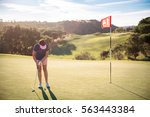 mature woman playing golf with... | Shutterstock . vector #563443384