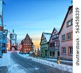 amazing winter in old town of... | Shutterstock . vector #563458339