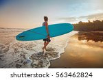 guy surfing on a sunset ... | Shutterstock . vector #563462824