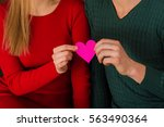 young couple in love holding a...   Shutterstock . vector #563490364