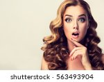 woman surprise showing product .... | Shutterstock . vector #563493904