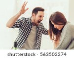 man and woman in disagreement... | Shutterstock . vector #563502274