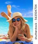 lying down woman sunbathing on... | Shutterstock . vector #563504704