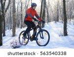 mountain biker riding bike on...   Shutterstock . vector #563540338