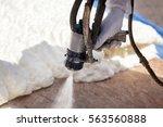 Technician Spraying Foam...