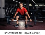 young man at a gym lifting a... | Shutterstock . vector #563562484