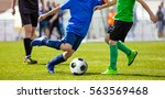 youth football teams playing... | Shutterstock . vector #563569468