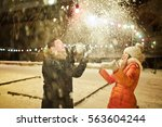 boy and girl playing with snow... | Shutterstock . vector #563604244