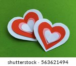 "Small photo of Overlapping cutting paper red heart isolated on green background. You can use as greeting card with text or with out text ""Happy Valentine's Day"""