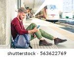 commuter traveler man looking... | Shutterstock . vector #563622769