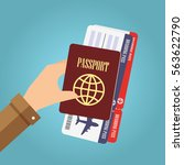 hand holding passport and... | Shutterstock .eps vector #563622790