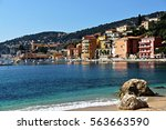 the harbor front in the town of ... | Shutterstock . vector #563663590
