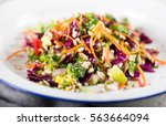 plates with colorful mixed... | Shutterstock . vector #563664094