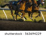 Stock photo horse race colorful bright sunlit slow shutter speed motion effect fast moving thoroughbreds 563694229