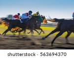 Stock photo horse race colorful bright sunlit slow shutter speed motion effect fast moving thoroughbreds 563694370