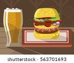 beer with double burger... | Shutterstock .eps vector #563701693