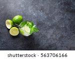 mojito cocktail on dark stone... | Shutterstock . vector #563706166