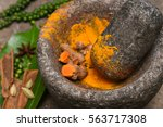 turmeric roots and powder in a... | Shutterstock . vector #563717308