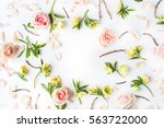 frame of pink roses  branches ... | Shutterstock . vector #563722000
