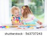 little boy and girl draw... | Shutterstock . vector #563737243