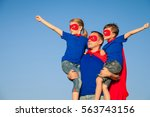 father and children playing... | Shutterstock . vector #563743156