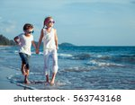 happy children playing on the... | Shutterstock . vector #563743168