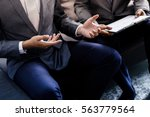 image of two young businessmen... | Shutterstock . vector #563779564
