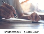 close up of casual man writing... | Shutterstock . vector #563812834