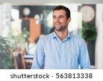 handsome entrepreneur thinking...   Shutterstock . vector #563813338