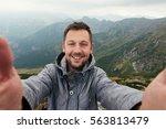 Smiling Hiker Taking A Selfie...